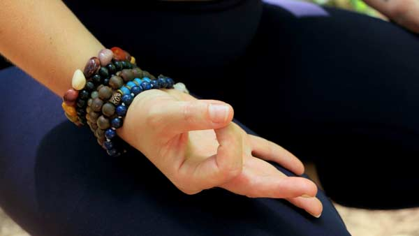 Sarah Melody yoga teacher yoga hand